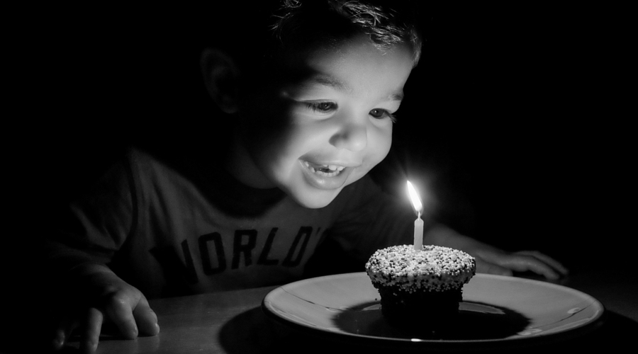 500px Photo ID: 61599205 - A simple confection elicits pure joy from a boy on his second birthday.